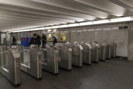 Passing through metro ticket barriers. shutterstock.com
