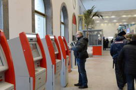 Self-service ticket kiosks at a railway station. shutterstock.com