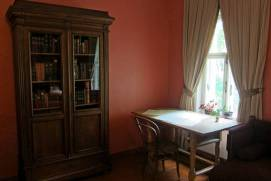 The house-Museum of Tchaikovsky in Klin. Table of Tchaikovsky in the bedroom