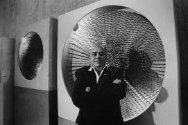 Günther Uecker posing in front of his works during an exhibition in 1988